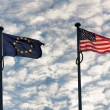 European and American flag waving next to each other — Stock Photo