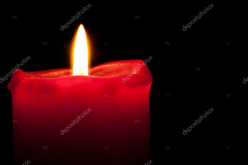 Red Candle burning with an orange flame in darkness — Stock Photo #10167744