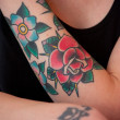 Flower Tattoo on Female Arm — Stock Photo