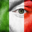 Flag painted on face with green eye to show Italy support — Stock Photo