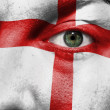 Flag painted on face with green eye to show England support — Stock Photo
