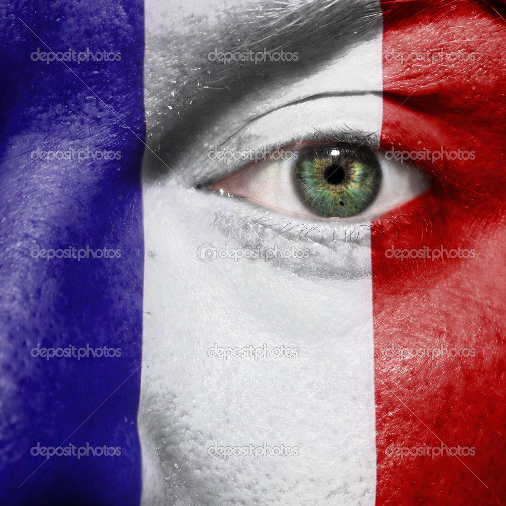 Flag painted on face with green eye to show France support in sport matches — Stock Photo #10445956