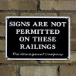 Signs Are Not Permitted on these railings on a wall — Stock Photo