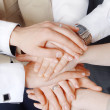 Business hands on top of each other — Stock Photo