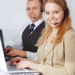 Closeup of customer service representatives — Stock Photo