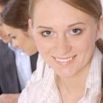 Closeup of a smiling young business executive — Stock Photo #10277920