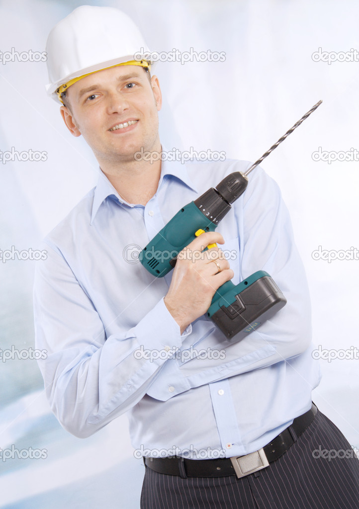 Full length of successful business man with cordless drill — Stock Photo #10277738
