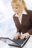 Closeup of a smiling young business woman with a notebook — Stock Photo
