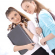 Stock Photo: Portrait of beautiful female students with notebooks