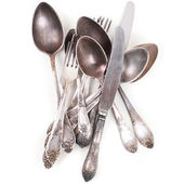 Silver spoons, forks and knifes isolated over white — Stock Photo