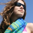 Young woman in sunglasses on a beach — Stock Photo