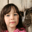 Little girl near forefather&#039;s house - Stock Photo