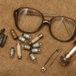 Stock Photo: Vintage glass vacuum radio tube, cartridges, glasses, lamps, saf