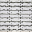 Stock Photo: Uneven white brick wall texture