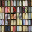 Shelf with different color ties — Stock Photo