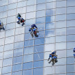 Six workers washing windows - Stock Photo