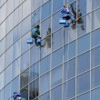 Window washers on a highrise office building in downtown — Stock Photo
