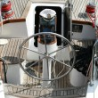 Rudder, compass and captain&#039;s hat on wooden yacht - Stock Photo