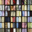 Multicolored male neck ties in a fashion store — Stock Photo