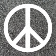 Peace symbol on asphalt - Stock Photo