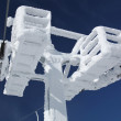 Construction of the ski lift covered with ice - Stock Photo