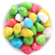 Multi colored candies on a little-little plate close up, isolate — Stock Photo
