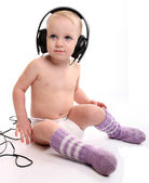 Baby with headphones — Stock Photo
