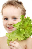 Girl holding salad leaf over white background — Stock Photo