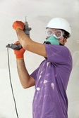 Handyman holding drill — Stock Photo