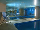 Indoor swimming pool with big mirror — Stock Photo
