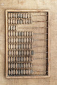Abacus (old calculator) on a sacking — 图库照片