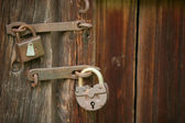 Two rusted padlocks on an old door — Stock Photo