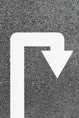 U-turn arrow on new asphalt — Stock Photo