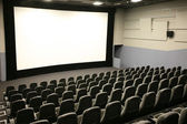 Modern cinema and wide white screen — Stock Photo