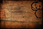Dark vintage wood table texture with cup stains — Stock Photo