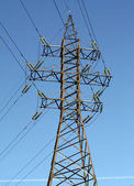 Electrical tower on a background of blue sky — Stock Photo