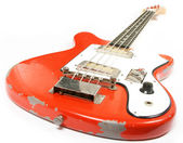 Red vintage bass guitar isolated on white background — Stock Photo