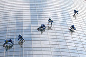 Six window washers — Stock Photo