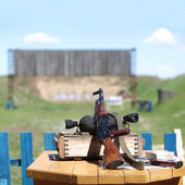 Submachine gun on shooting range. Soft focus — Stock Photo