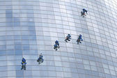 Six window cleaners — Stock Photo