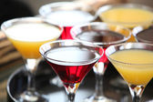 Alcohol cocktails on a tray (soft focus) — Stock Photo