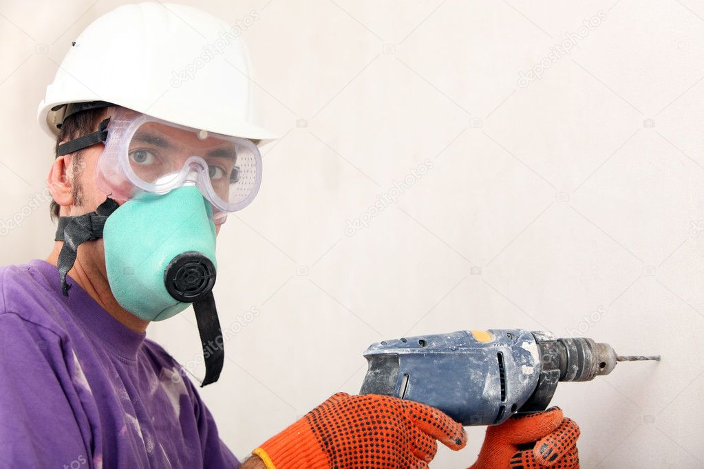 Worker holding drill — Stock Photo #9710562
