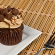 Peanut Butter Cupcake on Bamboo — Stock Photo