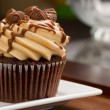 Stock Photo: Peanut Butter Cupcake on Wood