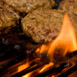 Royalty-Free Stock Photo: Grilling Burgers