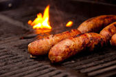 Grilling Brats — Stock Photo