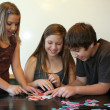 Sibling fun building a puzzle — Stock Photo