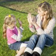 Mother and daughter playing in the garden — Stock Photo