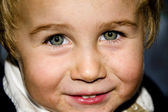 Little blond boy with a dirty face — Stock Photo