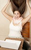 Girl gone crazy in front of laptop — Stock Photo
